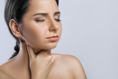 Throat Pain. Closeup Of Sick Woman With Sore Throat Feeling Bad,. Suffering From Painful Swallowing. Beautiful Girl Touching Neck With Hand. Illness, Health Royalty Free Stock Photo