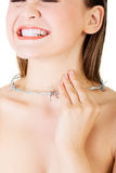 Throat pain concept. Young woman with barbed wire around her thr Royalty Free Stock Photography