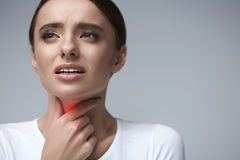 Throat Pain. Ill Woman Having Sore Throat, Painful Feeling. Throat Pain. Ill Woman With Sore Throat Feeling Bad, Suffering From Painful Swallowing, Strong Pain Stock Photo