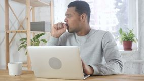 Throat soar, sick afro-american man coughing, sitting at work