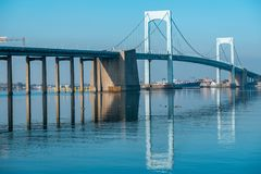 Throgs Neck Bridge with clear reflection in water. Viewed from Little Bay park on a sunny day in Beechhurst, Queens, NY stock photography