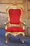 Throne. Emperor throne made with gold and red velvet Royalty Free Stock Photo