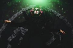 Throne of calavera catrina. Calavera Catrina sitting on a throne. Sugar skull makeup. Dia de los muertos. Day of The Dead. Halloween royalty free stock image