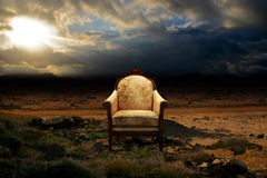 Throne in desolated rock desert. A ruined throne abandoned in rock desert Royalty Free Stock Images