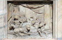 Throne of God and Four Living Creatures, marble relief on the facade of the Milan Cathedral. Duomo di Santa Maria Nascente, Milan, Lombardy, Italy stock images