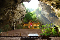 Throne in Prayanakorn Cave, Thailand. This throne situated in a cave on the mountain. There is chasm at the above and the light can shine through stock photography