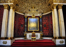 Throne Room, Winter Palace, St. Petersburg, Russia. The golden throne for queens, kings, and tzars sits in its royal reception room in the famed Winter Palace of Royalty Free Stock Photo
