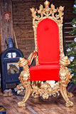 The throne of Santa Claus. Next to the wooden hut. Near the fireplace lay the wood and Christmas tree stands Stock Images