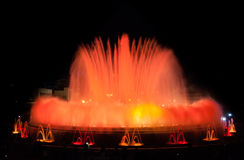 Throngs of people at the colourful light & water fountain show.  Night in Barcelona, Spain, at the magic fountain. Stock Photo