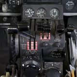Throttle quadrant in airplane. Throttle, prop and mixture levers with knobs and buttons and gauges in view Stock Images