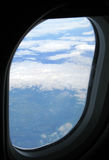 Throught the window. Airview through the aircraft's window. Clouds and sky Royalty Free Stock Photography