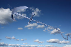 Throw of an anchor. Anchor and chain flying in the sky Royalty Free Stock Photos