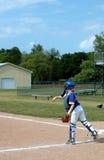 Throw The Ball. Teen girl's softball game Royalty Free Stock Image