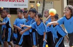 Throw a ball. Elementary school students learn to throw a ball in the city of Solo, Central Java, Indonesia stock photos