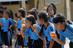 Throw a ball. Elementary school students learn to throw a ball in the city of Solo, Central Java, Indonesia royalty free stock photography