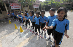 Throw a ball. Elementary school students learn to throw a ball in the city of Solo, Central Java, Indonesia stock photo