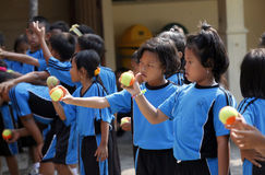 Throw a ball. Elementary school students learn to throw a ball in the city of Solo, Central Java, Indonesia royalty free stock photos