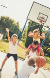 Throw the ball in my hands. Family playing basketball stock image