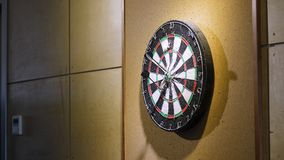 Throw the dart at the dart Board. Concept of success. Playing Darts Stock Image