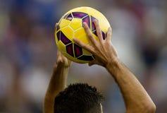 Throw-in during a football match. Footballer serving a Throw-in during a football match with his hands stock photos