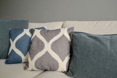 Throw pillows lie on a sofa. Living room interior fragment.  stock images