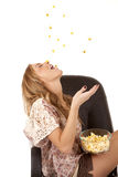 Throw popcorn into mouth Stock Photo