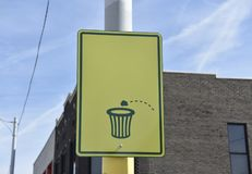 Throw your Trash in a Trashcan. A clean city beautiful sign urge`s people to throw their trash in a trashcan to keep the city and surrounding areas clean and royalty free stock image