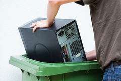 Throwaway old computer. Men throwaway hardware into container Royalty Free Stock Photos