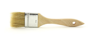 Throwaway paint brush. A side view of a throw away after use small paint brush Royalty Free Stock Photos