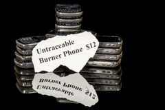 Throwaway phones stacked for twelve bucks Royalty Free Stock Photo