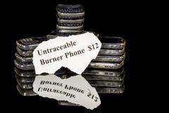 Throwaway phones stacked for twelve bucks. Mobile burner phones for sale Royalty Free Stock Photo