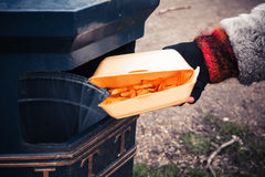 Throwing away chips Royalty Free Stock Photo