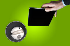 Throwing away an electronic tablet royalty free stock image