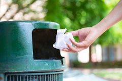 Throwing away trash Royalty Free Stock Images