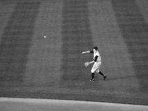 Throwing The Ball. Local farm team Baseball player throwing a baseball royalty free stock images