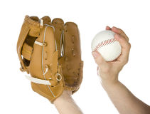 Throwing baseball into glove Royalty Free Stock Image