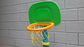 Throwing a basketball to a basketball hoop stock video