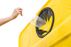 Throwing a bottle into the recycling container Royalty Free Stock Images