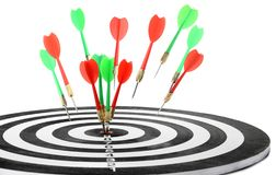Throwing color arrows into dart board on white. Background stock photos