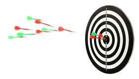 Throwing color arrows into dart board on white. Background royalty free stock photos