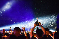 Throwing confetti over crowd at live concert Royalty Free Stock Image