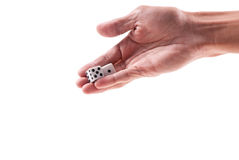 Throwing Dice. Small Pair Of Dice In Male Hand Royalty Free Stock Photo