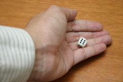 Throwing a dice. Dice in hand, focus on dice stock photos