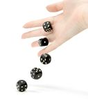 Throwing dices. Throwing black gambling dices isolated on white royalty free stock photography
