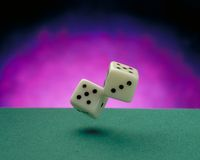 Throwing dices. On a green casino felt royalty free stock image