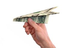 And throwing a dollar paper plane Stock Photography
