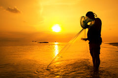 Throwing fishing net Royalty Free Stock Photos