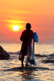 Throwing fishing net. During sunrise, Thailand stock photography