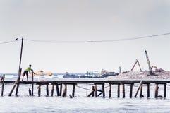 Throwing fishing net Royalty Free Stock Photos