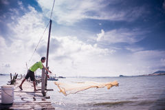 Throwing fishing net Royalty Free Stock Images